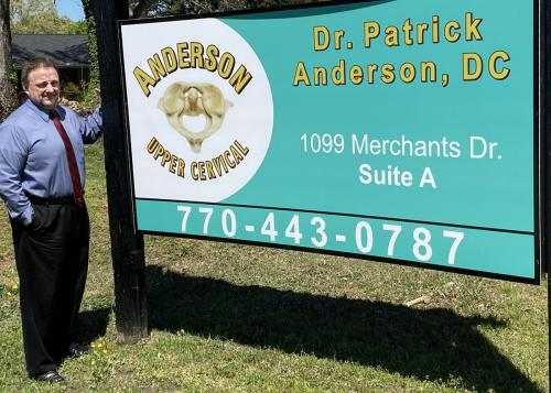 Dr. Anderson at street sign res